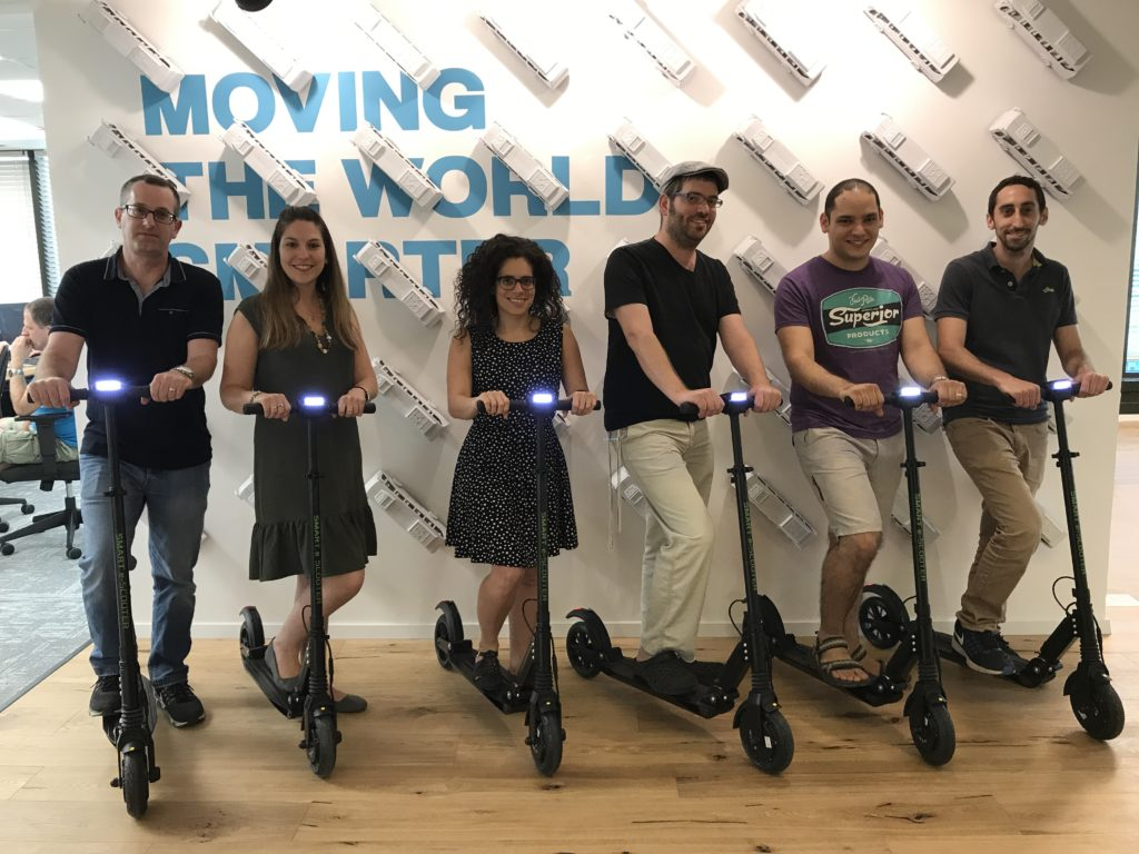 Optibus employee receives an electric scooter, electric bike, or hoverboard.